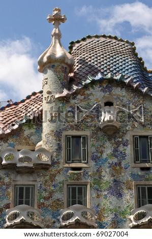 BARCELONA, SPAIN - 25 JULY: Exterior of Casa Batllo on July 25, 2010, a tourist destination restored by catalan architect Antoni Gaudi. Gaudi  decorated the facade with broken ceramic tiles. - stock photo