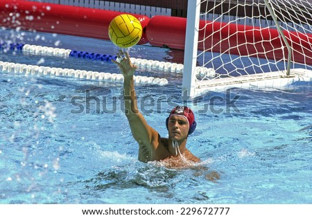 BARCELONA, SPAIN-JULY 16, 2003: italian water polo goalkeeper Stefano Tempesti in action during the World Water Polo Championship, in Barcelona. - stock photo