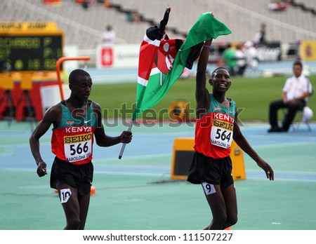 BARCELONA, SPAIN - JULY 15: L-R) Gilbert Kiplangat Kirui and Conseslus Kipruto - winners of 3000 Metres Steeplechase on IAAF World Junior Athletics Championships on July 15, 2012 in Barcelona, Spain - stock photo