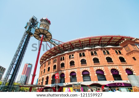 BARCELONA, SPAIN - JULY 19: Plaza de Espanya and Arenas bullring on July 19, 2012 in Barcelona, Spain. The old bullring, built in 1900, is since 2011 a shopping and leisure center - stock photo