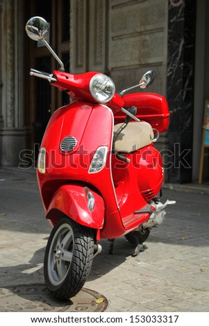 Barcelona, Spain - 2 july: Red scooter parked on street on 2 july, 2013. There are more then 20 000 scooters in Barcelona. - stock photo