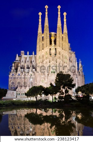 BARCELONA, SPAIN - JULY 12, 2014: Sagrada Familia church (Temple Expiatori de la Sagrada Famalia) in Barcelona, Spain. Designed by Antoni Gaudi, UNESCO World Heritage Site.  - stock photo