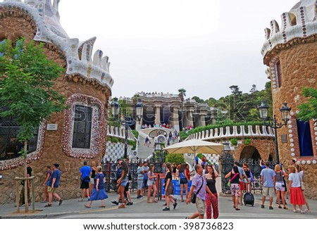 BARCELONA, SPAIN - JULY 31, 2015: View of the main entrance of the famous architectural landmark Park Guell in Barcelona, designed by renowned architect Antoni Gaudi and built between 1900 and 1914 - stock photo