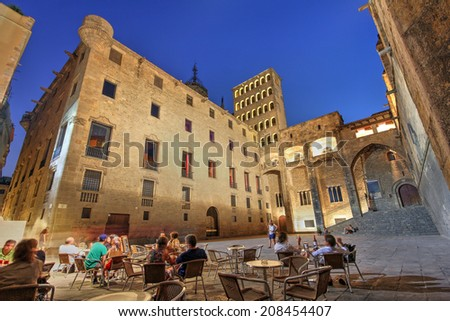 BARCELONA, SPAIN - JULY 30: Wide angle night composition of the medieval Placa del Rei in Barcelona, Spain on July 30, 2012. The square is dominated by the 14th century Palau Reial. - stock photo