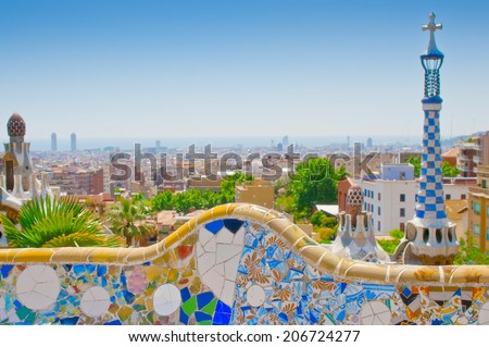 BARCELONA, SPAIN - JUN 11, 2014:  Ceramic mosaic Park Guell  in Barcelona, Spain. Park Guell is the famous architectural town art designed by Antoni Gaudi and built in the years 1900 to 1914  - stock photo