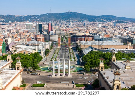 BARCELONA, SPAIN - JUNE 6: Aerial view of Barcelona, Spain, from Montjuic Hill on June 6, 2015. There are many important landmarks, such as Quatre Columnes,  Las Arenas or the Venetian Towers - stock photo
