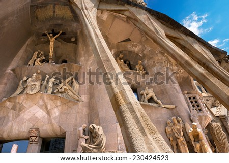 BARCELONA, SPAIN - JUNE 12, 2014: Details of the facade of the famous Catholic basilica of the Sagrada Familia in Barcelona, Catalonia, Spain. Designed by Antoni Gaudi. Start of construction, 1882 - stock photo