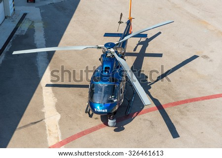 BARCELONA, SPAIN - JUNE 27. Helicopter on landing pad in the harbor of Barcelona on June 27, 2015. The rotorcraft offers Helicopter tours to sightseeing above Barcelona.  - stock photo