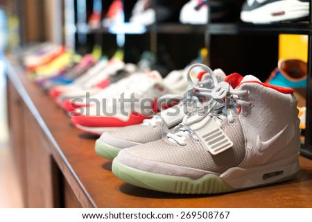 BARCELONA, SPAIN - 15 JUNE 2013 : in the shop Limited Edition presented of the most expensive sneakers nike company. Nike Air yeezy 2 Kanye West design worth 2500 euros or more. - stock photo