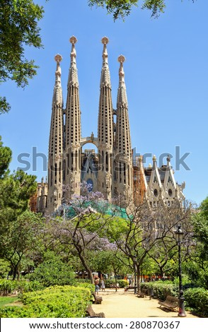 BARCELONA, SPAIN - JUNE 05, 2014: Sagrada Familia - Basilica and Expiatory Church of the Holy Family designed by Gaudi, which is being build since 19 March 1882 and is not finished yet. - stock photo