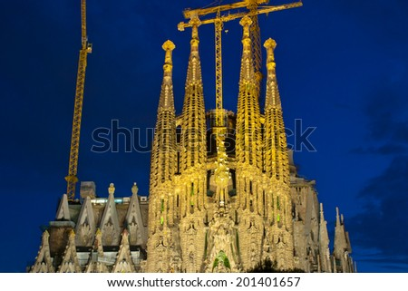BARCELONA, SPAIN - JUNE 19,2014: The Basilica of La Sagrada Familia at night. Designed by Antoni Gaudi, its construction began in 1882 and is not finished yet  - stock photo