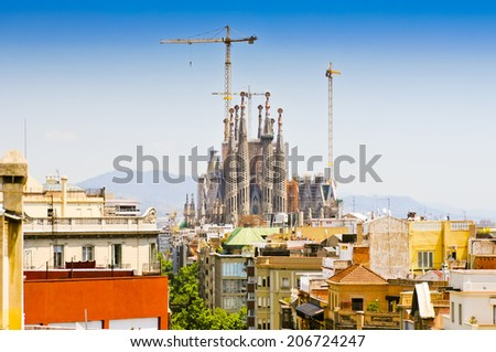 BARCELONA, SPAIN - JUNE 19, 2014: View on Basilica of La Sagrada Familia. Designed by Antoni Gaudi, its construction began in 1882 and is not finished yet  - stock photo