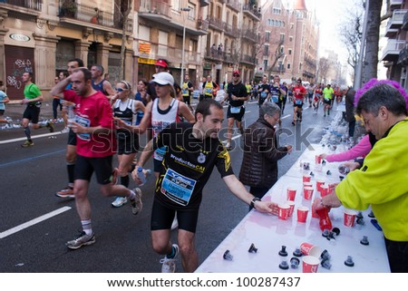 BARCELONA, SPAIN - MARCH 25: An unidentified athletes participate in the Barcelona marathon on March 25, 2012 in Barcelona, Spain. Over 15.000 runners took part in the 2012 edition. - stock photo