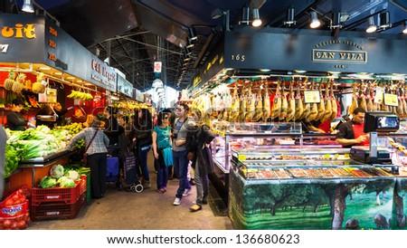 BARCELONA, SPAIN - MARCH 28: La Boqueria market in March 28, 2013 in Barcelona, Spain. The market is famous for its variety of fresh produce - stock photo