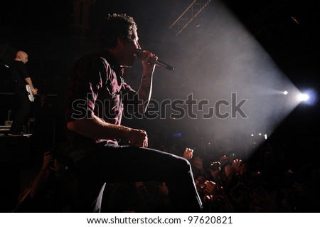 """BARCELONA, SPAIN - MARCH 13: Simple Plan band performs at Razzmatazz on March 13, 2012 in Barcelona, Spain. The band is currently on their """"Get Your Heart On!"""" tour. - stock photo"""
