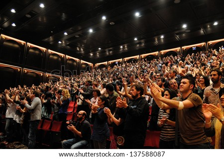 BARCELONA, SPAIN - MAY 3: Fans of Mishima band show their happiness applauding warmly at Teatre Lliure on May 3, 2012 in Barcelona, Spain. - stock photo