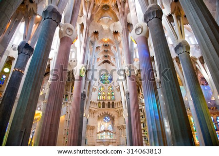 BARCELONA, SPAIN - MAY 02: Low Angle View of Pillars and Ceiling - Architectural Interior of Sagrada Familia Church, Designed by Antoni Gaudi, Barcelona, Spain. May 02, 2015. - stock photo