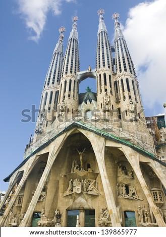 BARCELONA, SPAIN - MAY 31: Sagrada Familia on May 31, 2009: Basilica and Expiatory Church of the Holy Family (Basilica y Templo Expiatorio de la Sagrada Familia). Designed by Gaudi, - stock photo