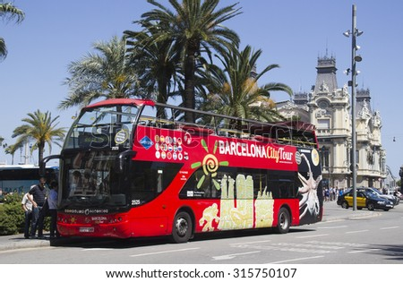 Barcelona, Spain - May 22, 2015: Tourists get on a double decker tour bus for an excursion in the harbor area of Barcelona, Spain on May 22, 2015. - stock photo