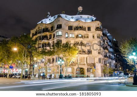 BARCELONA, SPAIN - NOVEMBER 6: Casa Mila on November 6, 2012 in Barcelona, Spain. This famous building was designed by Antoni Gaudi and built from 1906 until 1910. - stock photo