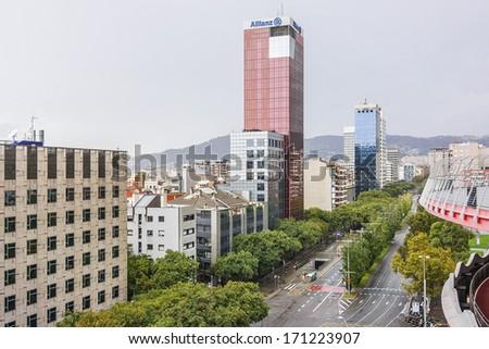BARCELONA, SPAIN - NOVEMBER 16, 2013: View of Edificio Allianz (Torre Allianz) - skyscraper on Carrer de Tarragona Street 103, near Spain square. Completed in 1993, has 20 floors, rises 77 meters. - stock photo