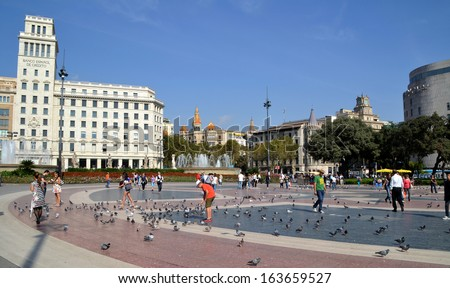 BARCELONA, SPAIN - OCTOBER 10: Catalonia Square in Barcelona, Spain on October 10, 2013. Plaza Catalunya is a central square in Barcelona with 30000 square meters, is the third largest square in Spain - stock photo