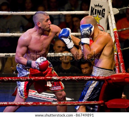BARCELONA, SPAIN - OCTOBER 15: Cesar Cordoba (L) and Nuno Lagarto fight at the fight4life Boxing - 86 kg event, on October 15, 2011, in Barcelona, Spain. - stock photo