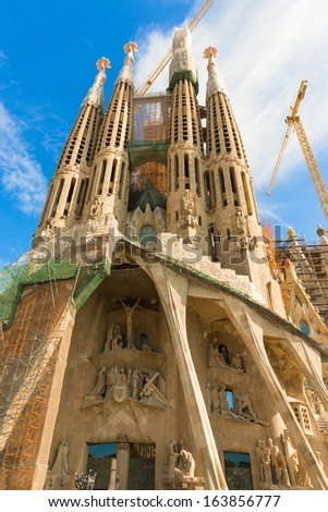 BARCELONA SPAIN - OCTOBER 10: La Sagrada Familia - the cathedral designed by Gaudi, which is being build since 19 March 1882 and is still under construction as of October 6, 2013 in Barcelona, Spain. - stock photo