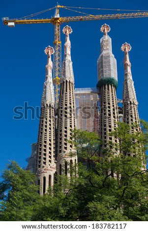 BARCELONA SPAIN - OCTOBER 28: La Sagrada Familia - the impressive cathedral designed by Gaudi, which is being build since 19 March 1882 and is not finished yet October 28, 2012 in Barcelona, Spain. - stock photo