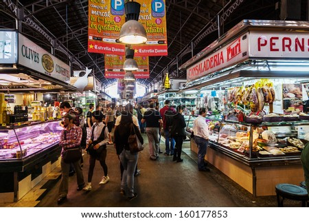 BARCELONA, SPAIN - OCTOBER 14: market hall La Boqueria with unidentified people on October 14, 2013 in Barcelona. La Boqueria is a famous and historical market hall on about 2.600 square meters. - stock photo