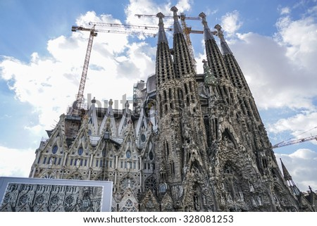 BARCELONA, SPAIN - OCTOBER 08, 2015: The Sagrada Familia Cathedral designed by Gaudi, which is being build since 1882 and is not finished yet. - stock photo