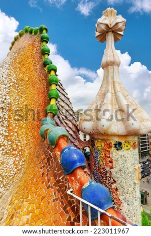 BARCELONA, SPAIN - SEPT  04, 2014: Roof, housetop  Gaudi's  creation-house Casa Batlo. Casa Batllo was built in 1877 by Antoni Gaudi, and now commissioned by Lluis Sala Sanchez.  - stock photo