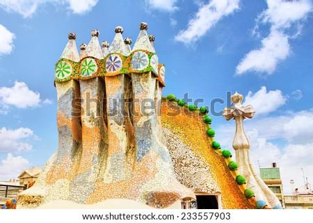 BARCELONA, SPAIN - SEPT  04, 2014: Roof, housetop  Gaudi's  creation-house Casa Batlo. Casa Batllo was built in 1877 by Antoni Gaudi. September 04, 2014 in Barcelona, Spain. - stock photo