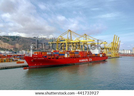 Barcelona, Spain - September 26, 2015: A container ships are standing in Barcelona port. It is Catalonia's largest port with a trade volume of 2.57 million TEU's. - stock photo