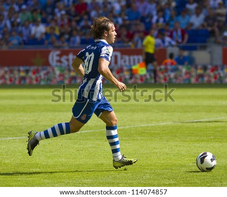 BARCELONA, SPAIN - SEPTEMBER 16: Joan Verdu of Espanyol in action during the Spanish League match between Espanyol and Athletic Club Bilbao, final score 3-3, on September 16, 2012 in Barcelona, Spain. - stock photo