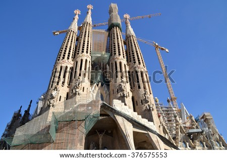 BARCELONA, SPAIN - SEPTEMBER 29: Sagrada Familia in Barcelona, Spain on September 29, 2013. Basilica and Expiatory Church designed by Gaudi, is being build since 1882 and is still under construction. - stock photo