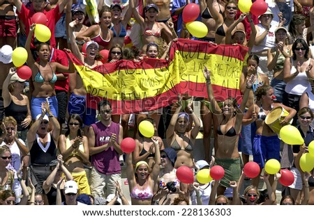 BARCELONA, SPAIN-SEPTEMBER 04,1999: Spain fans of the swimming synchronized team in action during the World Swimming Championship, in Barcelona. - stock photo