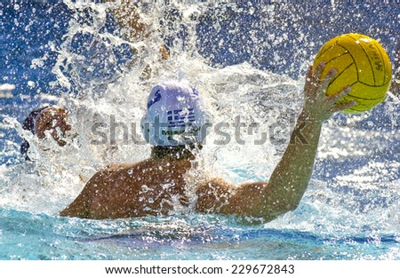 BARCELONA, SPAIN-SEPTEMBER 03, 1999: water polo player in action during the World Water Polo Championship, in Barcelona. - stock photo