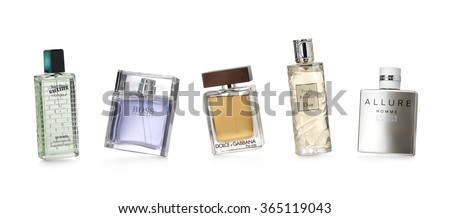 Barcelona-Spain-12 th December 2015- Studio shot of distinguished perfume brands for women and men photographed in a dynamic and funny positions. JPGaultier-Hugo Boss-Dolce&Gabbana-Dior-Chanel      - stock photo