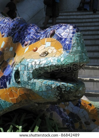 Barcelona symbol: ceramic dragon fountain at Parc Guell, the famous and beautiful park designed by Antoni Gaudi, one of the highlights of the city - stock photo