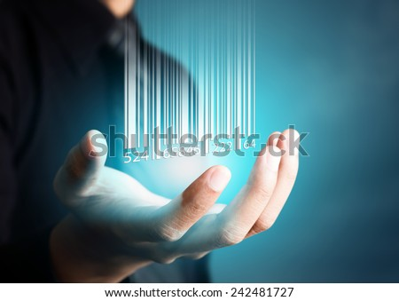 Barcode dropping on businessman hand, financial concept - stock photo