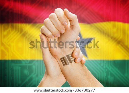 Barcode ID number on wrist of a human and national flag on background - Ghana - stock photo