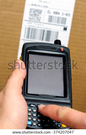 Barcode scanner Enterprise Digital Assistant computer with person typing on  the keypad - stock photo
