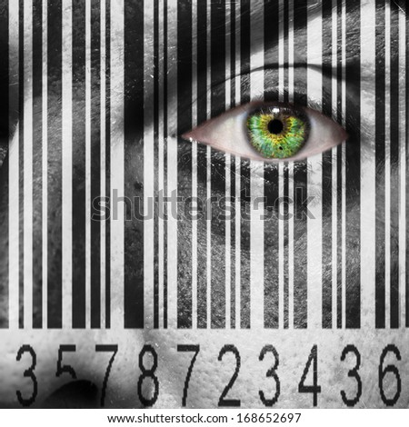 Barcode superimposed on a mans face to suggest the concept of slavery or human trafficking - stock photo