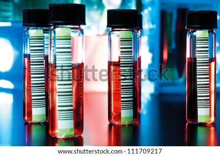 Barcoded medical samples in transparent tubes - stock photo