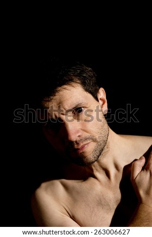 Bare Chested Man In Shadow - stock photo