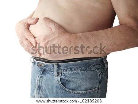bare-chested man with stomach ache - stock photo