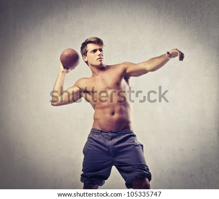 Bare-chested young man about to throw a basketball - stock photo