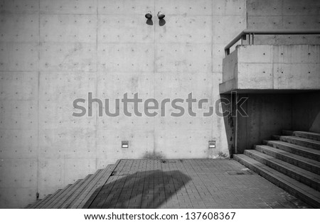 Bare concrete architecture with staircase - stock photo