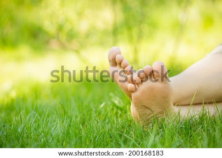 bare feet on green grass, copy space  - stock photo